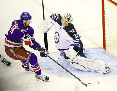 New York's Rick Nash was left alone against Jets netminder Ondrej Pavelec in the third period and he made no mistake, putting the Rangers up 4-2.
