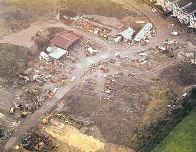 In this aerial photo, RCMP investigate Robert Pickton's Port Coquitlam, B.C., farm in 2002 - four years after author/ex-cop Lori Shenher passed along a tip about the compound.