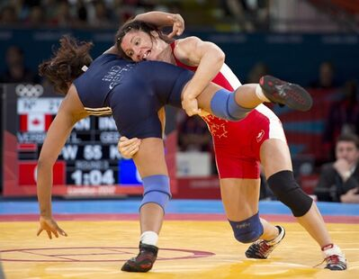 Canada's Tonya Verbeek lifts India's Geeta Geeta in their 55kg freestyle wrestling match at the 2012 Summer Olympics Thursday, August 9, 2012 in London.Wrestling Canada president Don Ryan thought it was a joke when he woke up Tuesday to frantic messages about his sport being dropped from the Olympic Games. He soon found out they were all too real. THE CANADIAN PRESS/Ryan Remiorz