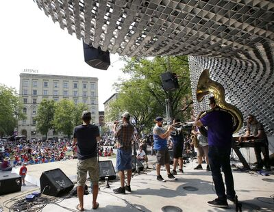 The Dirty Catfish Brass Band perform in the cube for Lunchtime Winnipeg Fringe Festival entertainment at Market Square in Winnipeg's Exchange District last week. The cumulative total of ticketed attendance in the first five days of the fest came in at 41,301, only slightly behind the 2015 record.