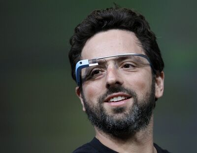 FILE - This June 27, 2012 file photo shows Google co-founder Sergey Brin demonstrating Google's new Glass, wearable internet glasses, at the Google I/O conference in San Francisco. Google is starting to notify 8,000 people who will be invited to buy a test version of the company's much-anticipated Internet-connected glasses for $1,500. The invitations are being sent to the winners of a contest conducted a month ago. Google asked U.S. residents to submit applications through Twitter or its Plus service to explain in 50 words or less how they would use a technology that is being hailed as the next breakthrough in mobile computing. (AP Photo/Paul Sakuma, file)