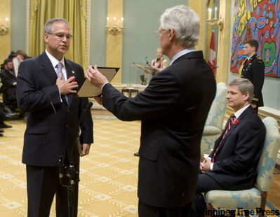 Minister of State (Science and Techology) Gary Goodyear is sworn in by Clerk of the Privy council Kevin Lynch as Governor General Michaelle Jean and Prime Minister Stephen Harper look-on, during a ceremony at Rideau Hall in Ottawa Thursday Oct 30, 2008.THE CANADIAN PRESS/Fred Chartrand