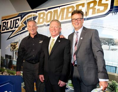 Tim Burke is all smiles after press conference at the Blue Bomber office Thursday afternoon after being officially announced the 29th head coach of the Winnipeg Blue Bombers by team President and CEO Garth Buchko (right) and GM Joe Black.