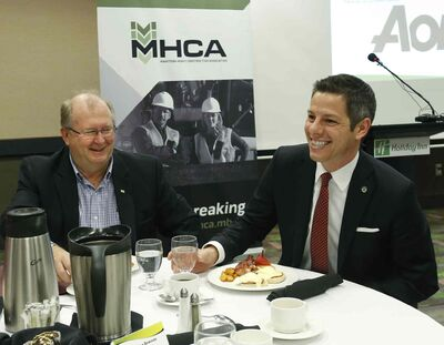 At right, Mayor Brian Bowman, with Chris Lorenc,  president of the Manitoba Heavy Construction Association at the MHCA Breakfast Friday.