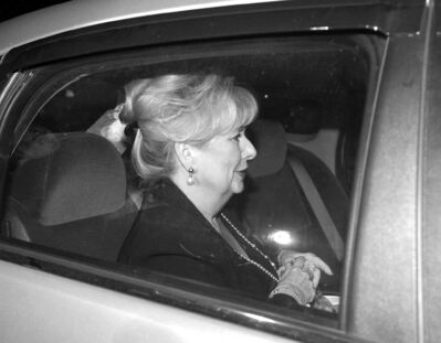 Sen. Pamela Wallin sits in a car on its way from Parliament Hill on Tuesday.