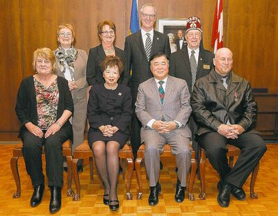 At the Caring Canadian Awards on Tuesday at Government House: Back row from left, Roma Maconachie for  award winner Phyllis Reader, Sonia Michalyshen, Robert Raymond Williams and Craig Houston.  Front row from left, Nancy Fleury, Anita Lee, Lt.-Gov. Philip Lee and Julian Austin.