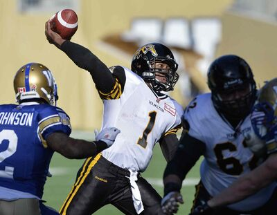 Hamilton Tiger-Cats' Henry Burris fires a touchdown pass against the Winnipeg Blue Bombers during the first half of CFL action in Winnipeg Saturday.