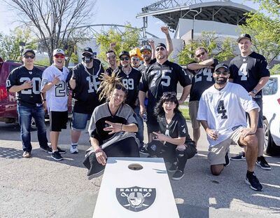 Raiders fans (and one daring Packers fan) take over a parking lot for a tailgate party before the NFL pre-season game between the Green Bay Packers and Oakland Raiders at IG Field Thursday evening.