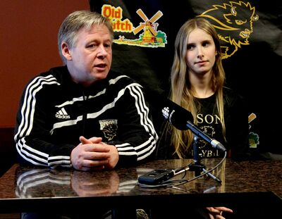 Bisons Women's Volleyball coach Ken Bentley (left) with Caleigh Dobie who is second in the Western Conference for digs.