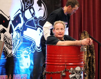 Escape artist Dean Gunnarson takes one last look around before being submerged in a metal container of water during an appearance at the Manitoba Water and Wastewater Association annual conference in 2012 at the Keystone Centre.
