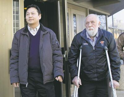 At left, Joe Chan with Coun. Harvey Smith leave the law courts building after attending the mayor's conflict-of-interest court case Tuesday.