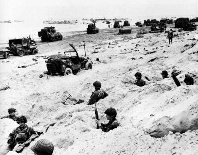American soldiers secure a beachhead at Normandy on June 6, 1944.