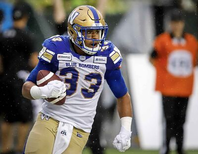 Blue Bombers' Andrew Harris celebrates his touchdown during the first half in Edmonton, Friday.