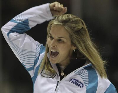 Skip Jennifer Jones throws her arm in the air after making a spectacular shot in the 10th end to win the 2012 Manitoba Scotties Tournament of Hearts in Portage la Prairie Sunday.