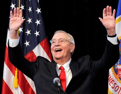 FILE - In an Oct. 30, 2012, file photo, former Vice President Walter Mondale, a former Minnesota senator, gestures while speaking at a Students for Obama rally at the University of Minnesota's McNamara Alumni Center in Minneapolis. Mondale, a liberal icon who lost the most lopsided presidential election after bluntly telling voters to expect a tax increase if he won, died Monday, April 19, 2021. He was 93. (AP Photo/Jim Mone, File)