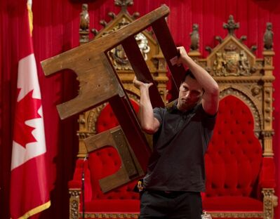 A Senate worker places benches in preparation for the Throne Speech on Parliament Hill in Ottawa, Thursday, October 10, 2013. The Throne Speech will be delivered Oct. 16. THE CANADIAN PRESS/Adrian Wyld