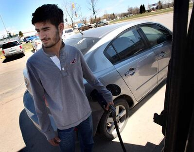 Student Harman Bhamrah dislikes the higher gas prices, no matter the reason.