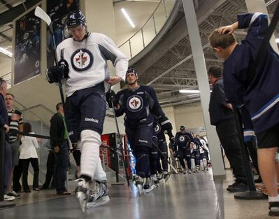 Axel Blomqvist leads a group of Winnipeg Jets prospects onto the ice at the MTS Iceplex for one last skate at the Winnipeg Jets Rookie Camp Thursday morning before the players catch a flight to Penticton, B.C., to play in the Vancouver Canucks Young Stars tournament.
