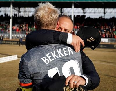 Hamilton Forge's head coach Bobby Smyrniotis, right, hugs captain Kyle Bekker following their victory in the Canadian Premier League soccer final against the Calgary Cavalry in Calgary, Saturday, Nov. 2, 2019. THE CANADIAN PRESS/Jeff McIntosh