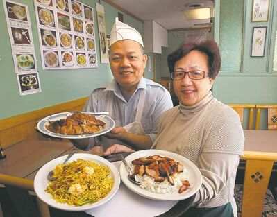 WAYNE GLOWACKI/WINNIPEG FREE PRESSEvergreen�s Teresa Lau, right, with curry vermicelli and barbecued pork, and her husband, Loy Lau, with barbecued duck.