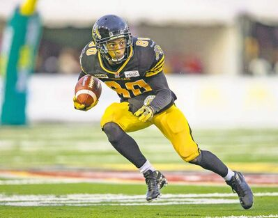 Geoff Robins / the canadian press archivesHamilton Tiger Cat Chris Williams is rewriting the CFL record book this season. He could do some damage to the Blue tonight.