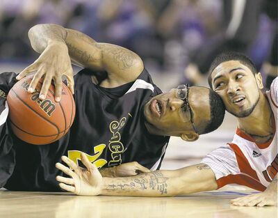 Wichita State's Carl Hall (left) and Louisville's Russ Smith struggle for a loose ball during the second half of their national semifinal game Saturday.