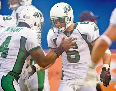 Saskatchewan wide receiver Rob Bagg (6) is congratulated by quarterback Darian Durant after scoring a first-quarter touchdown Thursday night.
