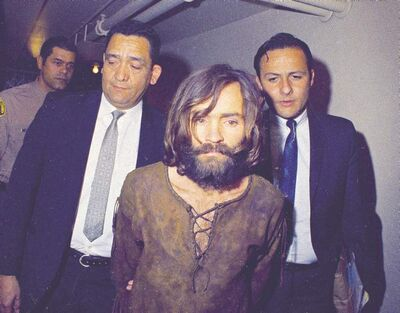This 1969 file photo shows Charles Manson being escorted to his arraignment on conspiracy-murder charges in connection with the Sharon Tate murder case in Los Angeles.