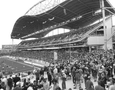 Fans attend a Bomber game at Investors Group Field.