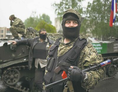 Pro-Russian gunmen guard the central square of Slovyansk, in eastern Ukraine, on Friday.