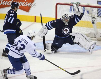 Ondrej Pavelec flashes the leather on ex-Leaf MIchael Kostka: with a sound defence in front of him, can Pavs be the answer?
