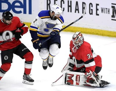 Ottawa Senators goaltender Anders Nilsson (31) makes a pad save as St. Louis Blues left wing Pat Maroon (7) jumps and Ottawa Senators defenceman Dylan DeMelo (2) defends, during third period NHL hockey action in Ottawa, Thursday March 14, 2019. THE CANADIAN PRESS/Justin Tang