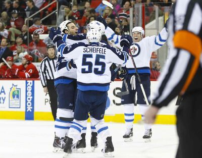 James Guillory / USA TODAY Sports Winnipeg's Chris Thorburn (left) is swarmed by teammates after potting the winning goal with 63 seconds remaining at PNC Arena. The Jets won for the ninth time in 11 starts under head coach Paul Maurice.