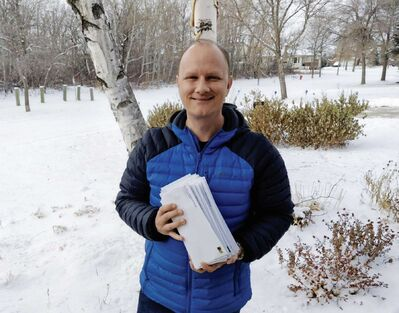 Rossmere MLA Andrew Micklefield is pictured here with a stack of letters he's about mail out to local businesses, explaining the details of the Manitoba Bridge Grant.