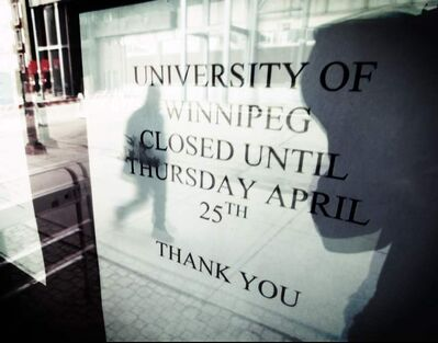 A sign at the University of Winnipeg indicates the campus is closed.