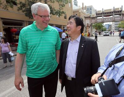Premier Greg Selinger and  Lt.-Gov. Philip Lee share a laugh during the 4th annual Chinese Street Festival in Chinatown in mid-August.