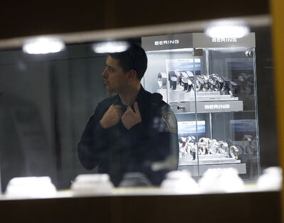 A police officer inside Fort Richmond Jewellers where the owner was was struck in the back of the head during a robbery.