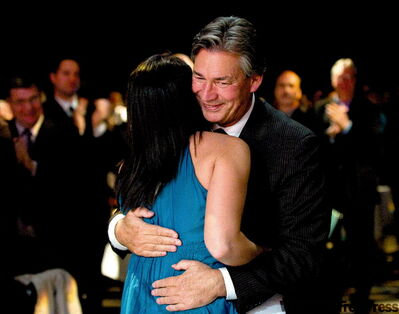 DAVID LIPNOWSKI / WINNIPEG FREE PRESS  Gary Doer and his daughter, Emily, share a special moment after she gives a surprise speech to her dad Friday night.