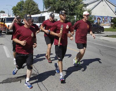 Cpl. Evan Maytwayashing with the Princess Patricia's Canadian Light Infantry (PPCLI)  takes his turn during the Memorial Baton Relay.