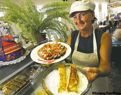 Jessie's Kitchen owner Jessie Plawna offers some potato pancake pizza and nalysnyky.