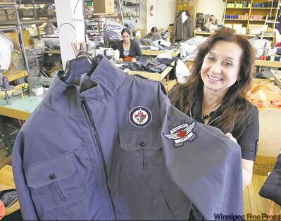 WAYNE GLOWACKI/WINNIPEG FREE PRESS Julie Land with a jacket her Pine Falls Clothing firm makes that is sold exclusively at the Jets Gear store.