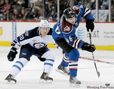 Jets' right-winger Antti Miettinen tries to chase down Avalanche defenceman Stefan Elliot during the first period of NHL hockey game Tuesday night in Denver. The Jets came out on top 4-1.