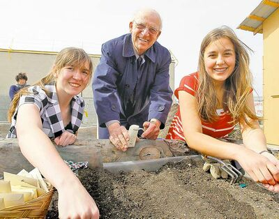 Grow a Row founder Ron O'Donovan with high school students Jamie Campbell and Julia Stoyko at Winnipeg Harvest.