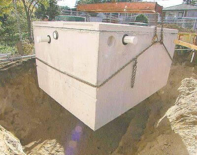 A cistern is installed on a residential property to store rainwater diverted from the home's roof, eavestroughs and downspouts. This water will be used for watering the lawn, washing vehicles and flushing toilets.
