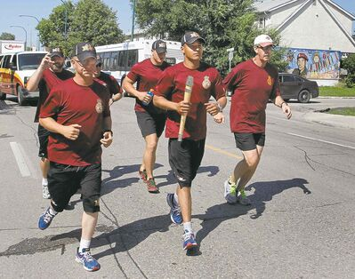 Cpl. Evan Maytwayashing takes his turn during the Memorial Baton Relay.
