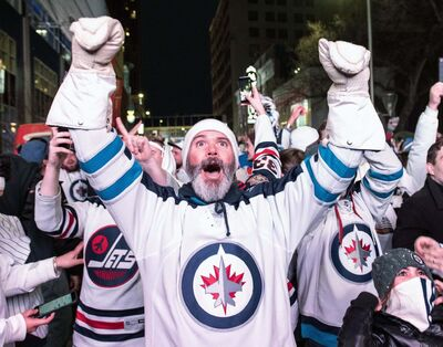 <p>Winnipeg Jets fans celebrate a win over the Minnesota Wild in game one of their NHL playoff series, Wednesday.</p>