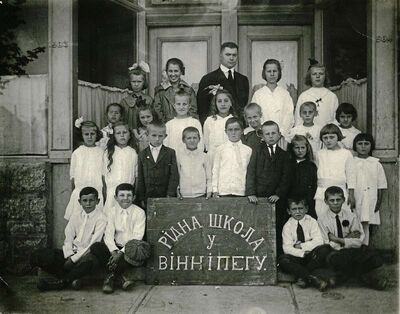 Teacher Yuriy Genyk poses with a class in front of the Ukrainian National Home Association's Ridna Shkola, or heritage school, in this 1916 photo. The building at the corner of Burrows Avenue and McGregor Street is still standing.