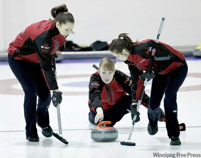 TREVOR HAGAN / WINNIPEG FREE PRESSSkip Alyssa Vandepoele tosses a stone while Abby Ackland (left) and Shayna Andries clear the path on Thursday.