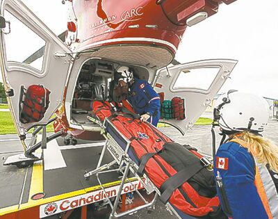 Melissa Tait / Winnipeg Free PressFlight nurse Rhonda Kaluzny (foreground) and flight paramedic Grant Therrien load a stretcher into the back of the STARS air ambulance, a Eurocopter BK117, on Tuesday.