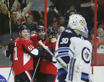 THE CANADIAN PRESS/Fred Chartrand</p><p>Ottawa Senators celebrate a goal on Winnipeg Jets goaltender Laurent Brossoit last Saturday in the Senators 5-2 in Ottawa.</p>